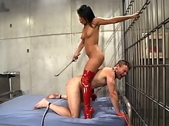 Mistress Jasmine visits her new prisoner with a few of her toys