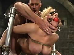Candy Manson is helplessly bound and face fucked.