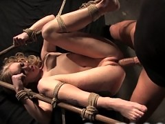 Tough model gets fucked hard in tight bondage.