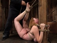 Bondage loving gal twisted into pretzel shapes.