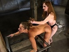 Lola tied up and dominated by another women.