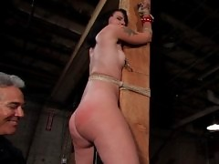 Leggy brunette gets very wet when she is bound, gagged and suspended