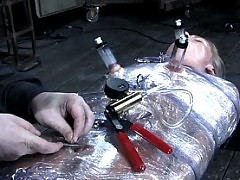 Dia Zerva in tight rubber gas mask breathplay bondage.