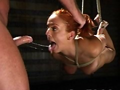 Gabriella, red head hottie, sucks cock in Japanese bondage.