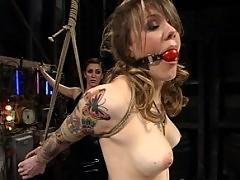 Tattooed babe gets a forced enema while tied up