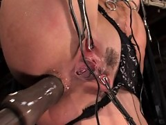 Wenona is bent into crazy bondage positions and ass fucked