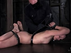 Sexy mature MILF in leather straps and chain bondage