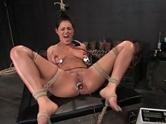 Brunette with natural 34DD's gets her tits tied and shocked
