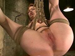 Natural redhead in rope bondage and fucked with pain play.