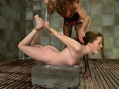 Sexy brunette gets cold punishment from a giant block of ice.