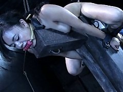Annie Cruz gets bound and controlled in harsh iron restraints.