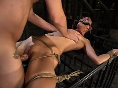 Dana is fucked in the ass while in bondage.