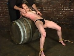 Torque places Nina over a barrel, then tickles and torments her.