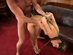 Sahara Knite endures the pain of bondage as she gets fucked.