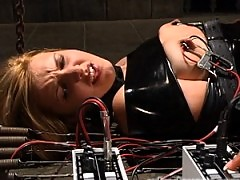 Isis Love squirts her cum all over a tied up beauty