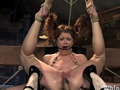 Redhead in hard bondage and domination.