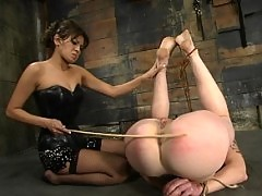 Mistress Cole drives a big cock deep inside her slaves ass.