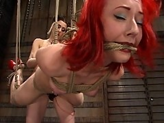 Sabrina Sparks is bound upside down, strap-on fucked, and flogged